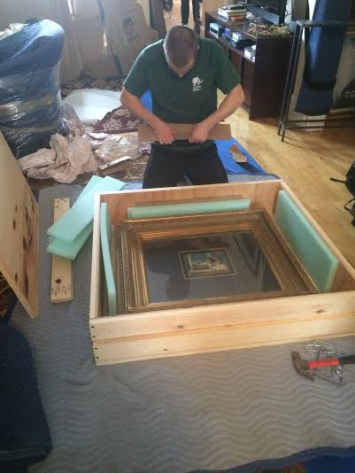 Packing art in wooden crates