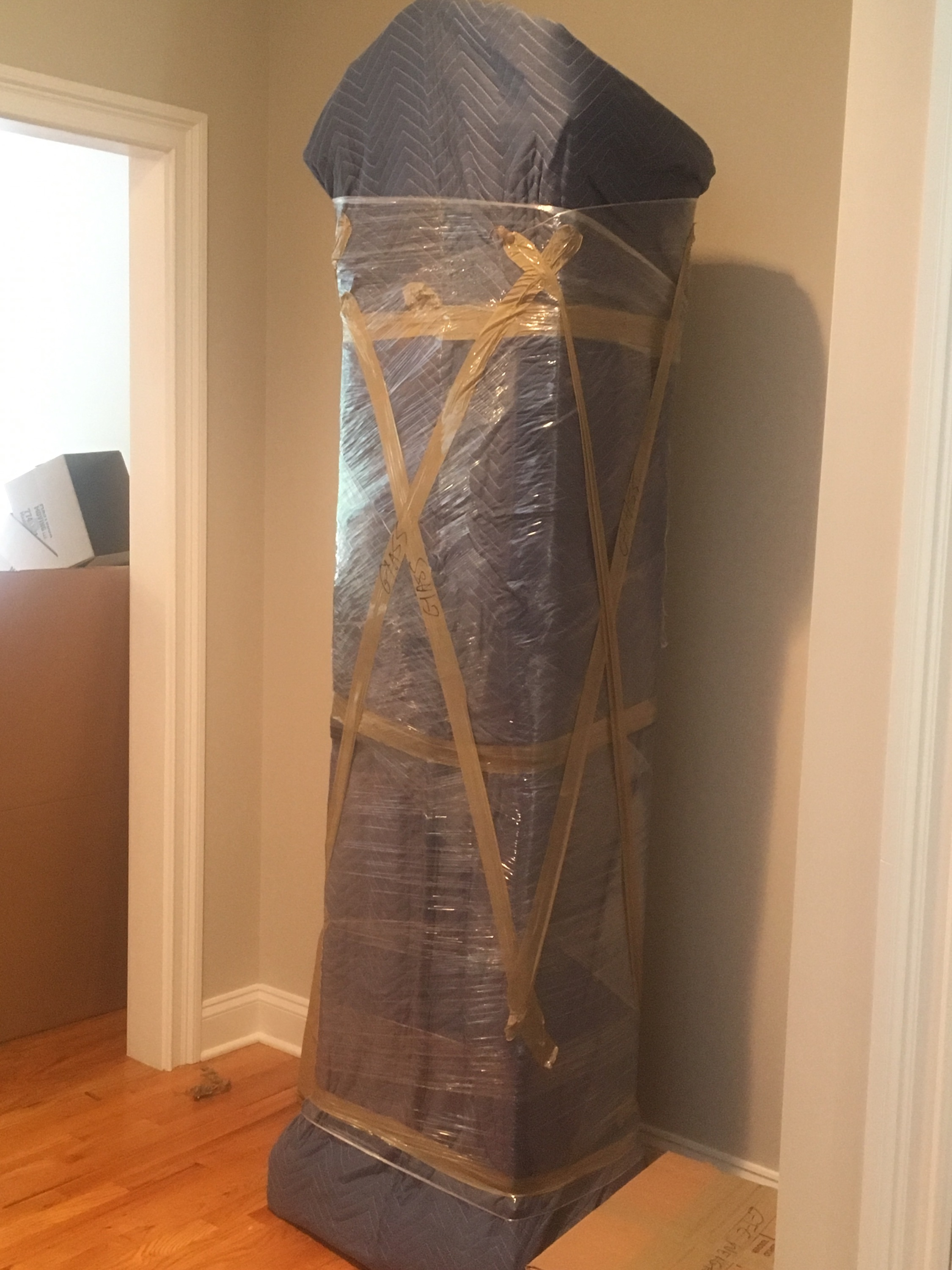 pad-wrapped grandfather clock