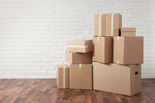 cardboard moving boxes stacked in home