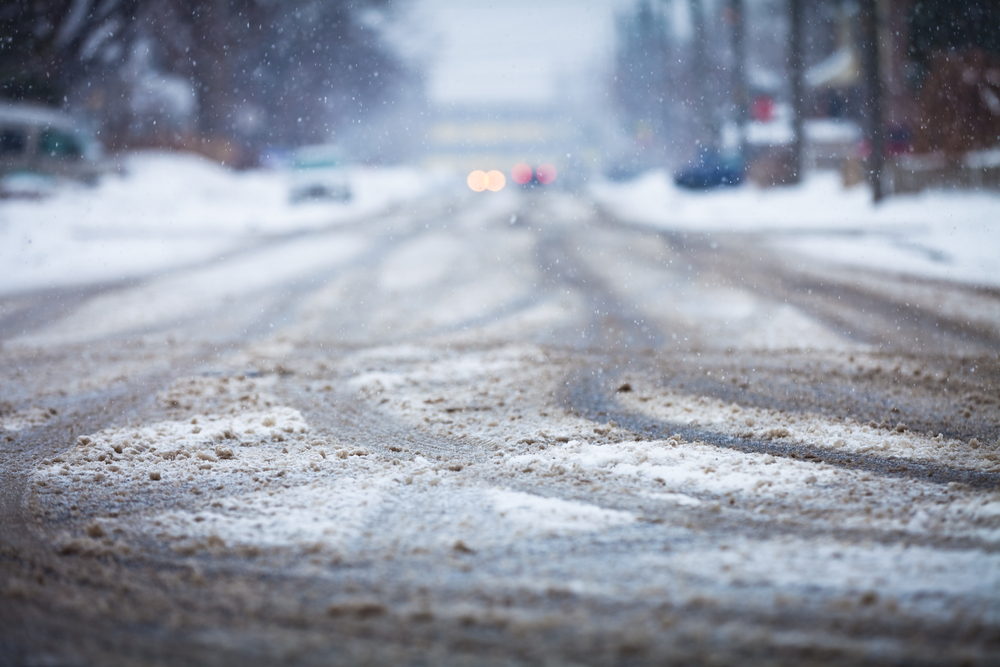 A photograph of a snowy road.