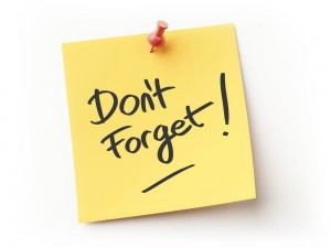 "A photograph of a post-it note reading, ""Don't Forget!"""