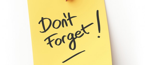 """A photograph of a post-it note reading, """"Don't Forget!"""""""