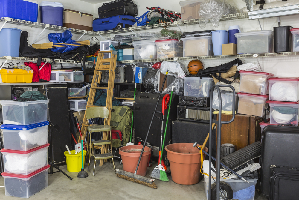 A photograph of a cluttered garage.